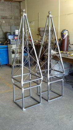 Branch Studio, Custom made Obelisks made to fit inside a flower planter box. Vines will grow up the iron work with flowers inside. Bottom of iron base will be in placed in the planter box. Obelisk Trellis, Garden Trellis, Wooden Pergola, Diy Pergola, Curved Pergola, Welding Projects, Garden Projects, Metalarte, Craft Iron