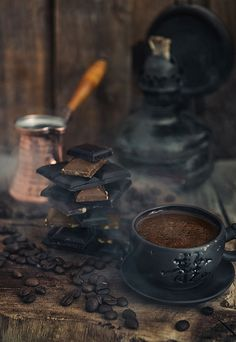 Dark food photography - coffee anf chocolate on wooden table