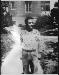 Elvis in front of his home, Lauderdale Courts, Memphis, ca. 1949