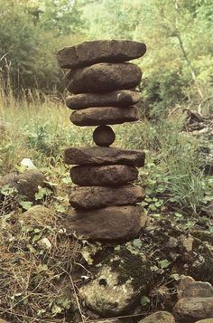 Andy Goldsworthy whenever I see rocks balancing in a field I have to look. It's harder than it looks!