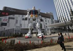 A full-size model of Japan's popular robot animation character Gundam stands in front of a new shopping mall at Tokyo's Odaiba waterfront area on Tuesday. The 18-meter-tall Gundam greets shoppers at Diver City Tokyo Plaza which opens on Thursday.