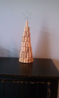 Wine cork Christmas tree! ...I hot melt glued the corks around a foam flower cone. Stuck a wire star in the top. Had a blast making this over a few glasses of wine with girlfriends!