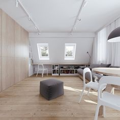 The key to great interior design when it comes to small spaces is being able to use the same space for more than one purpose. In this top floor apartment, locat