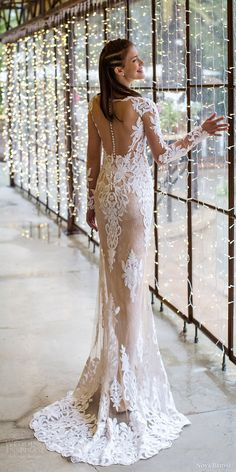 noya bridal 2016 illusion long sleeve scalloped sweetheart illusion jewel sheath wedding dress / http://www.deerpearlflowers.com/fall-winter-long-sleeve-wedding-dresses/