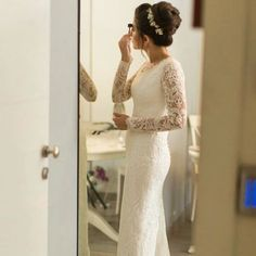 Long sleeve wedding dress designs with sheer lace sleeves like this can be custom recreated for you with any change you need.  Obtain pricing and details on long distance orders when you visit our main website.