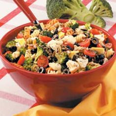 Poppy Seed Pasta Salad Recipe -Broccoli, cauliflower and sunflower kernels give this colorful salad an enticing crunch. You can add almost any vegetable that suits your fancy to this surprising simple recipe.