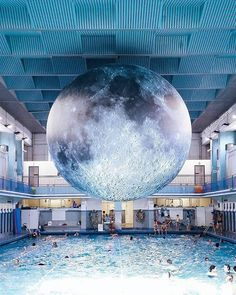 """Fancy a swim under the moon?"" writes Aurélie (@afadingsummer) in the caption for her photo of artist Luke Jerram's work, which is displayed in Rennes, France, through this weekend. ""It's a huge helium balloon with detailed NASA imagery of the lunar surface,"" she says. ""It looks so real, and even lights up at night. I love that you can see people swimming in the pool, indifferent to this big moon hanging above them."" 🌝 #TheWeekOnInstagram  Photo by @afadingsummer"