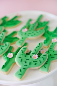 Birthday party cactus sugar cookies. Pink and green frosting. Sprinkles and edible flower. Dessert inspiration. Cactus Party styling by Happy Wish Company. Photography by Tammy Hughes Photography. Stationery by Minted artist, Baumbirdy.