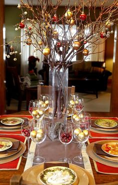 Katie Lunne's centerpiece in her Grafton Hill dining room is made up of mostly natural, easy to find, and inexpensive items. It is made of tree branches and colorful holiday ornaments.