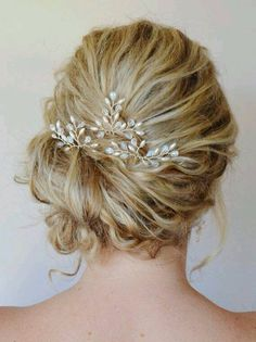 Side swept up do with small beaded piece