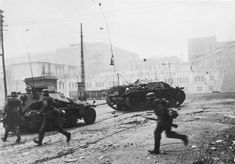 German infantry and armoured vehicles battle the Soviet defenders on the streets of Kharkov, October 1941.  Deutsches Bundesarchiv (German Federal Archive)