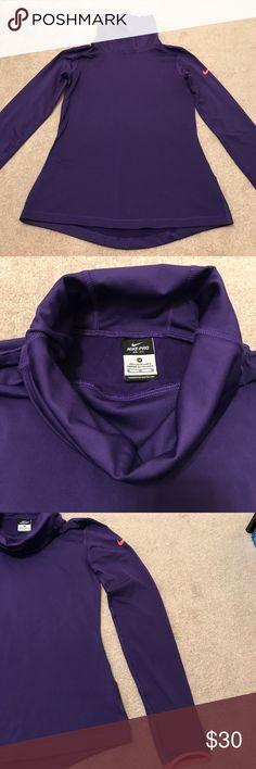 Nike purple turtleneck pullover Nike dri-fit purple turtleneck pullover. Never worn Nike Tops Sweatshirts & Hoodies