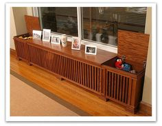 Radiator covers. Looks like an old record box. Maybe hidden speakers on the sides.