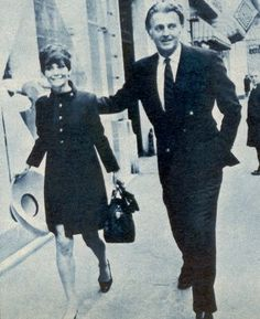 Audrey Hepburn photographed with her beloved Hubert de Givenchy in theRue de Grenelle, after a lunch. Paris, May 1968. -Audrey was wearing a Givenchy coat (navy blue, of his haute couture collection for the Autumn/Winter 1967/68), holding her hat also of Givenchy, shoes of Roger Vivier and handbags of Gucci and Louis Vuitton.