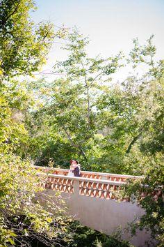 whimsical real wedding couple on bridge