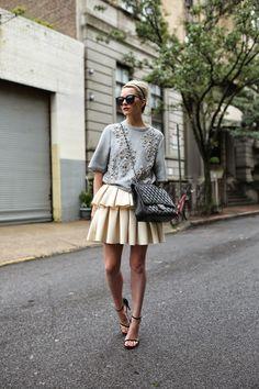 Atlantic Pacific street style wearing Asos skirt, 3.1 Phillip Lim detailed top, Chanel handbag, Stuart Weitzman strappy heels, Karen Walker sunglasses.
