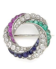 A ruby, sapphire, emerald and diamond brooch/pendant, circa 1915 The circular brooch composed of entwined crescents of old brilliant and single-cut diamonds and calibré-cut sapphires, rubies and emeralds, with millegrain detail throughout, diamonds approx. 1.50cts total, diameter 2.7cm