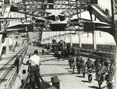 Title: Procession crossing Bridge - Sydney Harbour Bridge construction Dated: 19/03/1932 Digital ID: 12685_a007_a00704_8734000141r Series: NRS 12685 Sydney Harbour Bridge Photographic Albums Rights: No known copyright restrictions www.records.nsw.gov.au/about-us/rights-and-permissions We'd love to hear from you if you use our photos/documents. Many other photos in our collection are available to view and browse on our website using Photo Investigator.