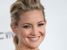 Actress KATE HUDSON forced herself to smile through the pain of an impacted wisdom tooth after suffering a dental nightmare during a recent modeling shoot.