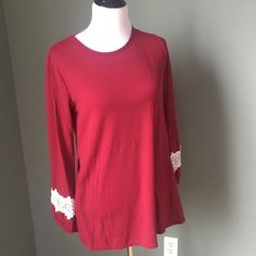 Cute Long Sleeved Shirt with Lace Detail So cute! Has lace design on sleeves & pockets as well! Scoop neck. Have Medium & Large Avail in Wine Red. Have an XL in Red. Runs small.Please allow me to make a personal listing for you. All I need is the color & size you would like. Thanks!! Lisa's Closet Tops Tees - Long Sleeve
