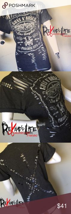 """PARADISE CITY"" • upcycled revamped GNR tshirt •••☠️ BUNDLE & SAVE ☠️ DM ME TO BUNDLE! ☠️ WILL CONSIDER *ALL* REASONABLE OFFERS!  ""PARADISE CITY"" • OFFICIAL GUNS 'N ROSES dark gray stretchy woman's tee! Has stretch to it, will fit small, medium, large. Cut, torn, distressed look. VINTAGE. Is a bit of a thinner cotton.   Size medium  #gunsnroses #gunsandroses #gnr #vintage #vtg #retro #classic #rock #paradisecity #distressed  #cutup #torn #shortsleeve #custom #reconstructed #revamped…"