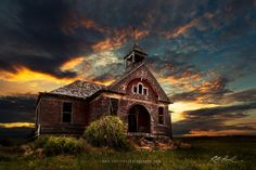 A beautiful sunset frames this long abandoned school house in Washington.