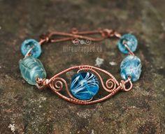 OOAK Blue eye copper lampwork wire wrapped bracelet. €35.00, via Etsy.