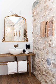 The luxury suites at The Sir George in Jugiong feature ensuite bathrooms. This one, in a converted granite stone horse stable features a timber vanity, brass mirror and exposed stonework Granite Bathroom, Stone Bathroom, Ikea Bedroom Storage, Boutique Hotel Room, Timber Vanity, Limestone Wall, Stone Cottages, Rustic Stone, Ensuite Bathrooms
