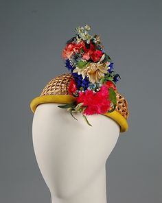 Hat  Sally Victor  (American, 1905–1977)    Date:      1955  Culture:      American  Medium:      Straw, synthetic  Credit Line:      Brooklyn Museum Costume Collection at The Metropolitan Museum of Art, Gift of the Brooklyn Museum, 2009; Gift of Sally Victor, 1955
