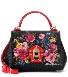 Dolce & Gabbana - Lucia floral leather handbag - Add instant decadence to your ensemble with this Lucia handbag, crafted from embossed leather and painted with exquisite flowers. Red accents and gold tone hardware make this piece irresistibly luxurious. Carry yours wearing a black midi dress and cat-eye sunglasses for a look that turns heads. seen @ www.mytheresa.com