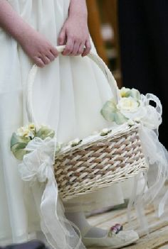 Flower girl basket-Take an ordinary basket and attach two Oasis Iglus to the sides with chenille stems, add your flowers and finish with a lovely wired bow.+
