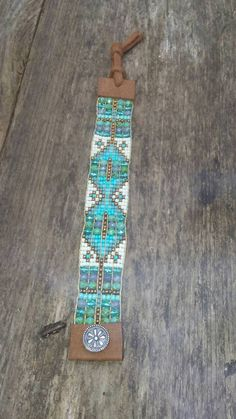Southwest influence boho chic Native American hand-loomed this handmade bracelet measures 1 inch wide and closes with a sterling silver handmade button fit size 6 to 8 inch wrist