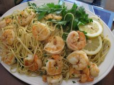 This is a light pasta dish with plenty of shrimp, garlic, and lemon. I have reduced the amount of lemon and salt from the original recipe to suit my DBFs tastes. The leftovers are just as good heated up in the microwave the next day.