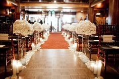i. love. this. Beautiful white aisle wedding decor - two of those at the back of the isles would be enough