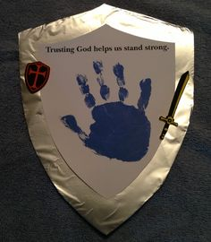 VBS 2013 Day 4 Foil covered poster board shield with card stock shield on top. Use craft paint for hand print. Decorate with VBS stickers or foam shapes.