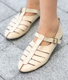Faux Leather Cutout Sandals  Airy faux leather sandals give your feet enough ventilation for the summer heat. T-strap closure with buckle detail. Available in beige and black. Faux leather. Wipe clean. By SO Central, Hong Kong.  US$38.00