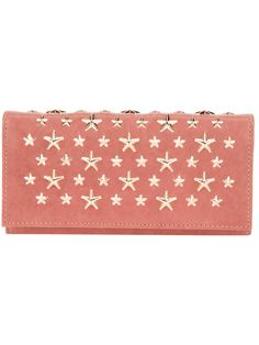 Dusky pink calf leather 'Nikita' purse from Jimmy Choo featuring a front flap closure, multiple card slots, a separate zip pocket, a note compartment, a gold-tone chain trim and a gold-tone stud detailing.