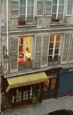 Looking through the windows of Paris apartments & Bistro