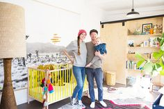Adorable family in bright and eclectic nursery