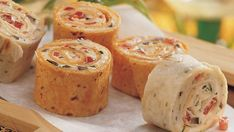 Cream cheese complements crunchy red bell pepper and olives in a vegetarian appetizer.