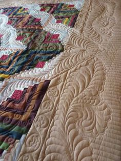 I like how the feathers extend out into the border....by fourseasonsquiltswap, via Flickr
