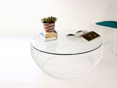 Sculptural coffee table with geometric details and glass top