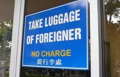 Take Luggage of Foreigners No Charge Sign
