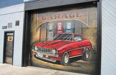 Before whoever was here left, they painted a remarkable muscle car mural on the garage door.