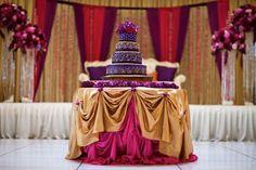 Google Image Result for http://maharani.wpengine.netdna-cdn.com/wp-content/gallery/wedding-cakes/indian-wedding-three-tiered-purple-gold-wedding-cake-2.jpg