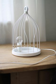 Fly away, bird cage table light.