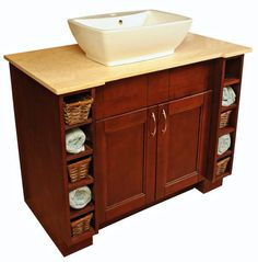 Bordeaux Shaker Custom Vanity-  To create this we actually used kitchen cabinets to create a very functional bathroom vanity with plenty of storage for towels and small baskets.  The top is a custom cut top with vessel sink.