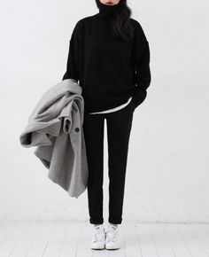 black wool sweater with black trousers and white sneakers
