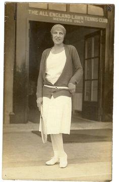 Suzanne Lenglen outside the All England Lawn Tennis Club, Wimbledon. Even quite a dull cardigan looks stylish on Suzanne, as she ties it with a contrast belt.