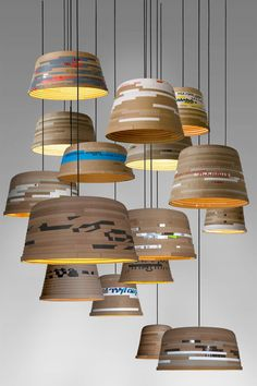 Cute pendant lamps made with recycled cardboard, the lampshade reflects the material and produces particularly warm light. Source